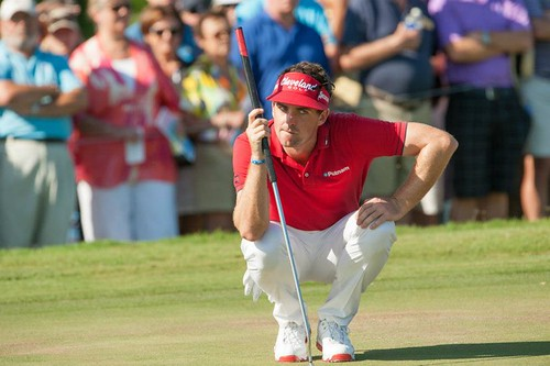 Keegan Bradley reads a putt during the final r...