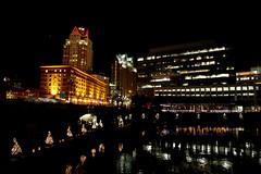 Christmas lights augment the city lights.
