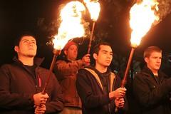 Torches light way.