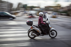 Woman riding a scooter in Roma