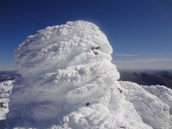 A Mt. Madison cairn on the Appalachian Trail covered in rime ice.