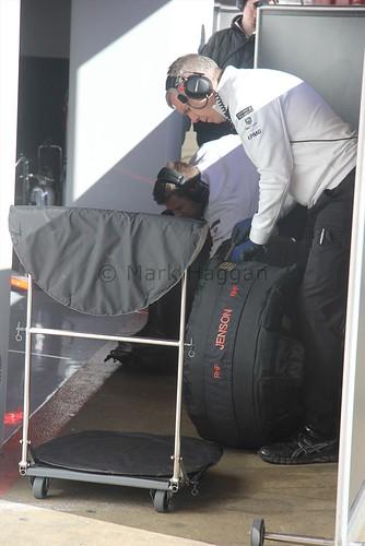 McLaren mechanics prepare Jenson Button's tyres during Formula One Winter Testing 2015
