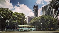 Kolkata on a Friday morning! This was onw of those days when the clouds were so  beautiful that pretty much everything was a great frame. More coming soon.  #calcutta #urban #skyline #streets #cityscape #city #citylife #bus #traffic #trees #skyscraper #hi