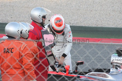 Jenson Button gets out of his stopped McLaren in Formula One Winter Testing 2015