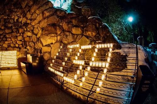 """Candles at the Grotto spell out, """"Lisa,"""" in memory of Lisa Yang, a McGlinn Hall senior who died Tuesday."""