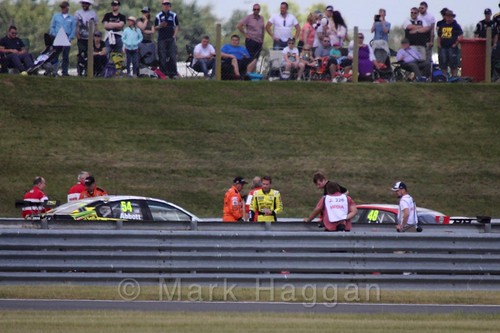 Hunter Abbot and Ollie Jackson after their crash in the second Touring Car race during the BTCC 2016 Weekend at Snetterton