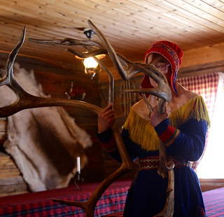 Sami and male reindeer antlers