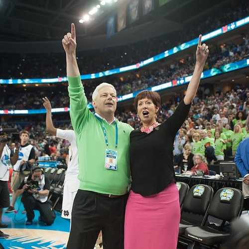 Muffet McGraw and her husband, Matt, sing the Alma Mater to celebrate @ndwbb's win to advance to its second consecutive national championship game. (Photo credit: Wei Lin | The Observer)