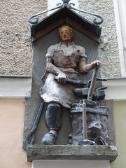 Statue relief on a building in Salzburg - the city is full of them, totally delightful