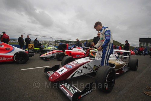 Sennan Fielding getting into his car ahead of the British Formula Four race 2 during the BTCC Knockhill Weekend 2016