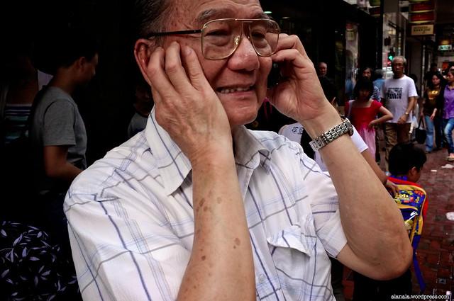 On the phone in a noisy street