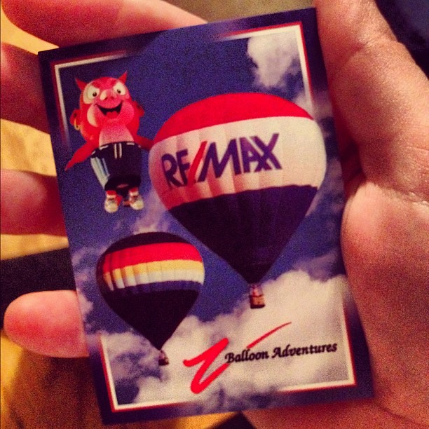 We missed the balloon landing in Renee's yard, but we got to see it get dismantled! Then we got a trading card.