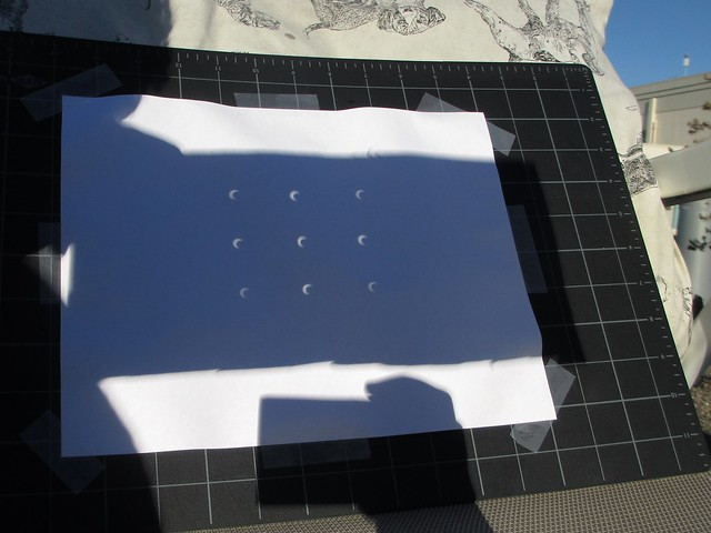 The solar eclipse viewed through a DIY pinhole projector.