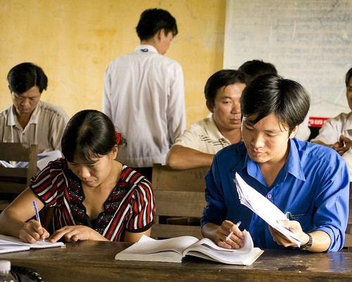 Two community health workers read over notes at the Vietnam EcoZD training session in Binh Phuoc Province, Vietnam