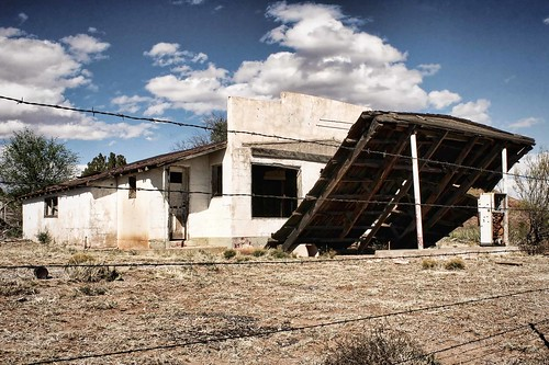 Abandoned old filling station, its canopy collapsed. Route 66, New Mexico. Copyright Jen Baker/Liberty Images; all rights reserved.