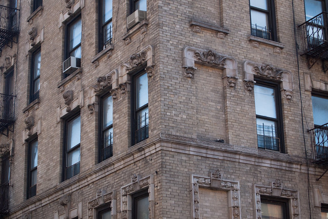 Detail of the windows and lintels on 1st Avenue. Photo by Ellen Brenna Dougherty