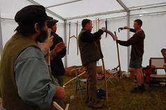 Demonstrating scythe set-up to new teachers