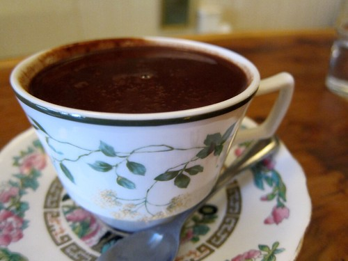 A teacup full of thick hot chocolate.