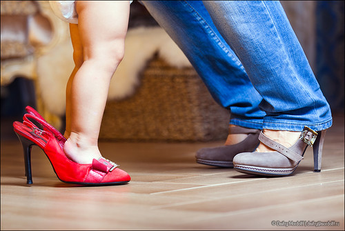 Mother and daughter in high heel shoes