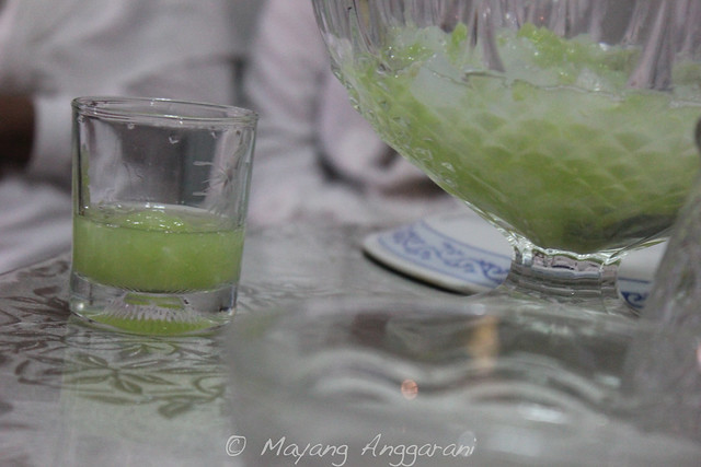 Delicate strings of cucumber in simple syrups with ice cubes. A soothing dessert after all those spicy dish.