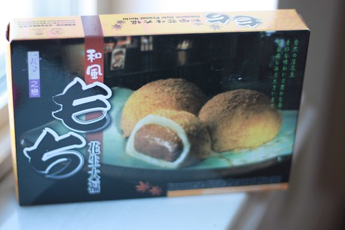 Head-on shot of a box of Japanese Style Peanut Mochi. There are Japanese characters on the box.