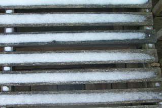 More gentle snow on a seat on the porch