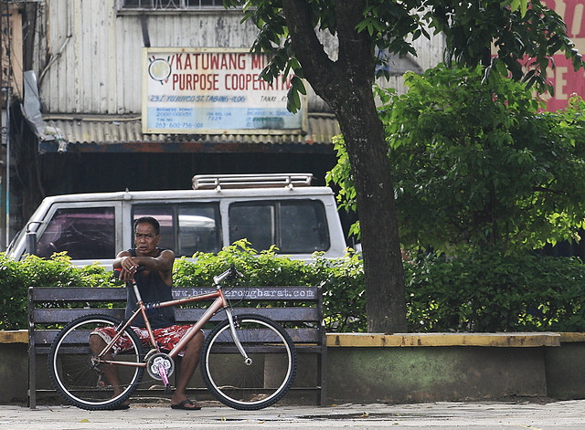 Man with bike sitting on a bench tanay park rizal province
