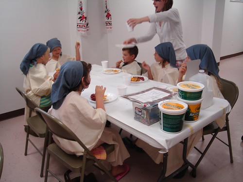Children doing crafts in Biblical Costumes