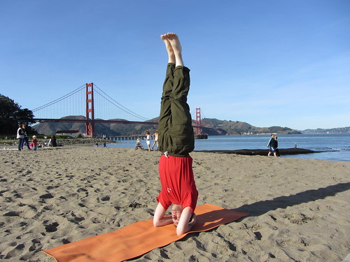 headstand on the beach