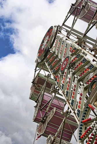 A light-studded carnival ride at a local fair rises high into the air. Copyright Jen Baker/Liberty Images; all rights reserved.