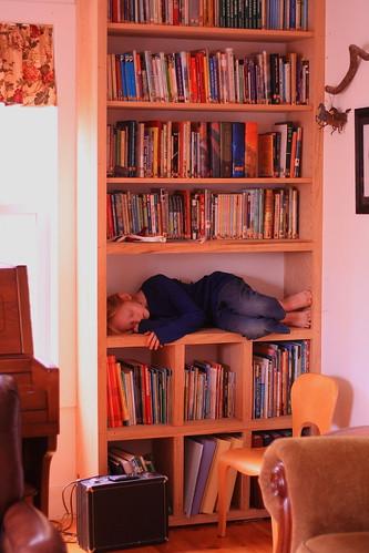 Rachel on bookshelf