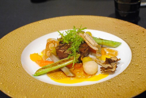 Grilled beef served with seasonal vegetables and a natural gravy