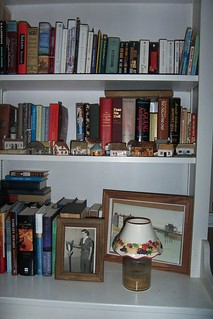 Some books live in the dining room in the shelves Paul built to use for china... oh well... Note photo of Paul getting his Eagle Scout Award...my hero!