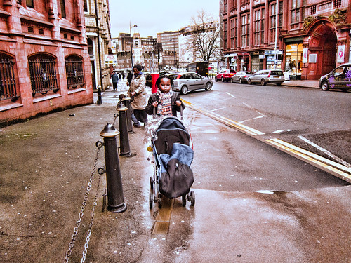 Girl with pushchair - 2012 by Stuart Chard