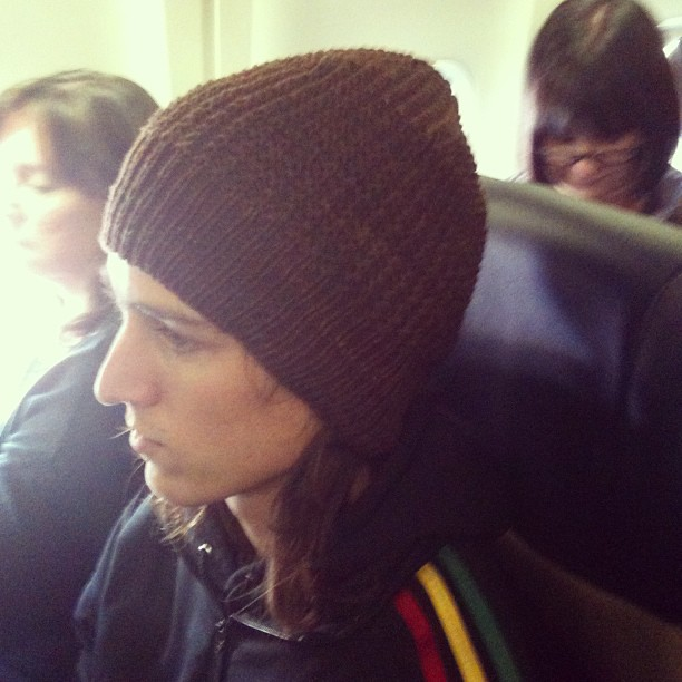 Finished a hat on the plane, gave it to my seatmate Walker, a DePaul senior, with wishes for a warmer Chicago winter.
