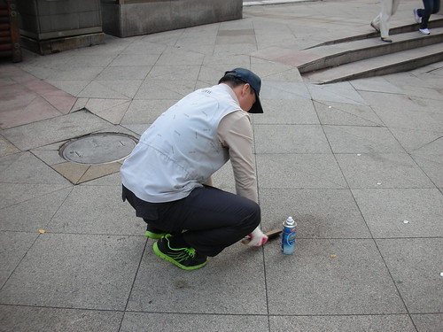 Cleaning a Gum from the Sidewalk of Seoul