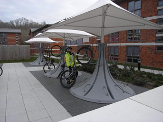 Suzanne tries out the umbrella cycle racks