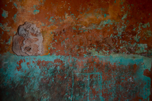 rust and teal paint job wall jaipur india chipped