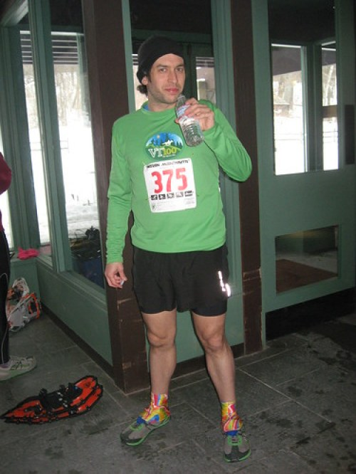 man with water bottle wear snow gaiters with running shoes