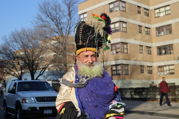 Man with elaborate headgear at Three Kings' Day Parade