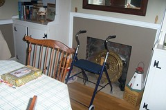 My walker that I had to buy after I fell down the side deck stairs and hurt my body so I could barely walk. It doesn't have a home in our home except here in the dining room.