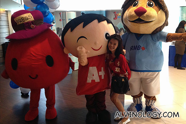 The respective mascots from The Straits Times Little Red Dot, The Big Spell and RHB Bank