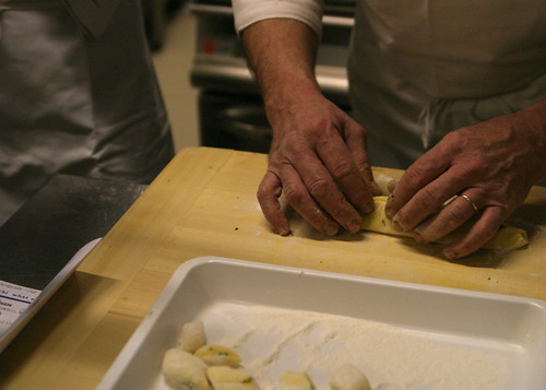 Stuffing the gnocchi with arugula and cheese