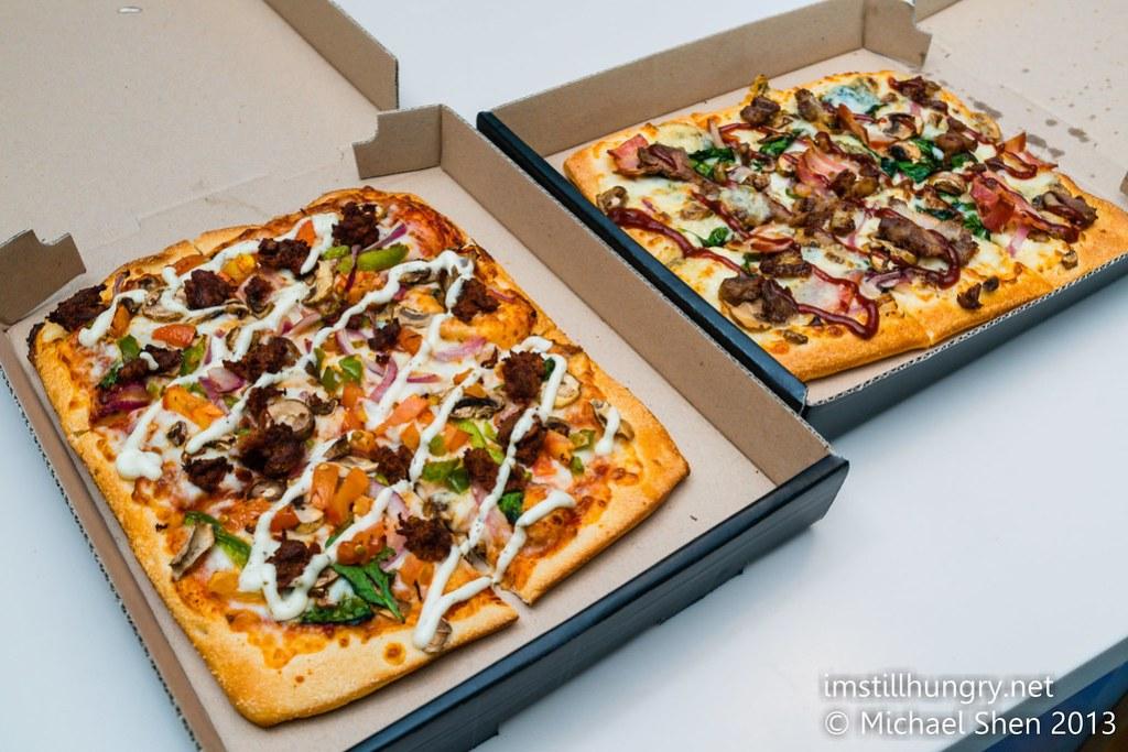 Domino's Chef's Best pizzas Left: Shiraz Lamb & Tomato w/mint yoghurt sauce Right: BBQ Duck & Blue Cheese w/BBQ sauce