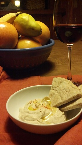 Fruit, hummus & pita, wine.