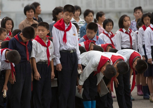 North Korean Pioneers Going To Pay Respect To The Dear Leaders At Mansudae Art Studio, Pyongyang, North Korea