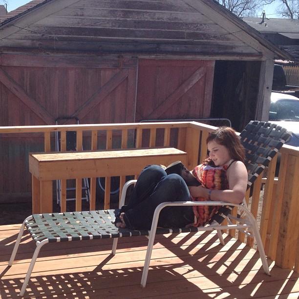 Codie reading in a sunbeam
