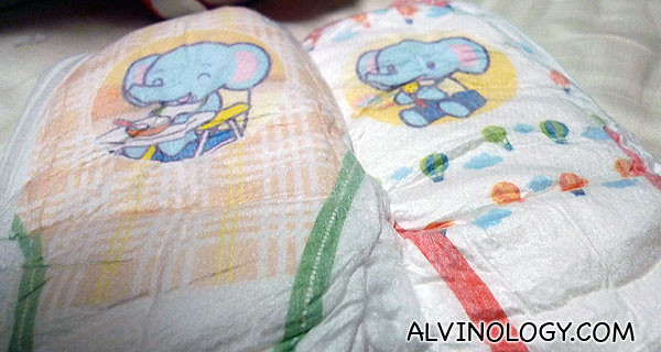 There are different cartoon elephants on the diapers