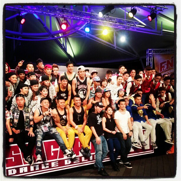 The 12 finalist dance teams for F&N Singapore Dance Delight Vol 4 on stage with the judges