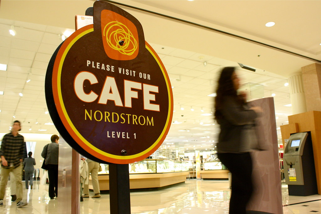 Customers pass a Cafe Nordstrom sign as they exit the store on Friday May 3, 2013. A food handler of the cafe has recently been diagnosed with typhoid fever. Photo by Gabriella Gamboa / Xpress.